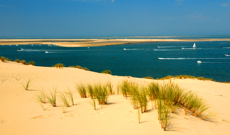 The Atlantic Coast from Arcachon (famous for its oysters and the Dune du Pilat) to Le Verdon-sur-Mer has miles and miles of unspoilt beaches facing the mighty Atlantic