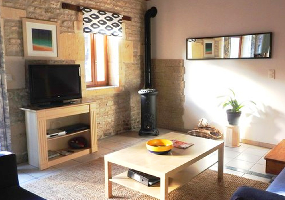 La Charente Gallery Image / living room showing coffee table, sofa and tv viewing area