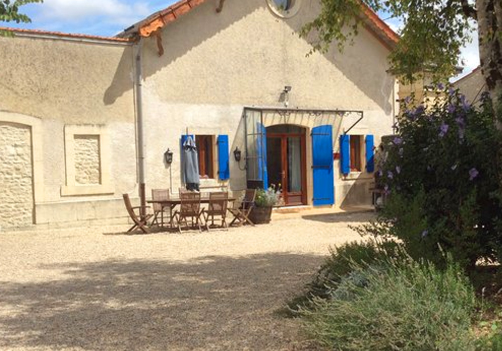 La Charente Gallery Image / outside photo showing front door and outside eating area of the courtyard