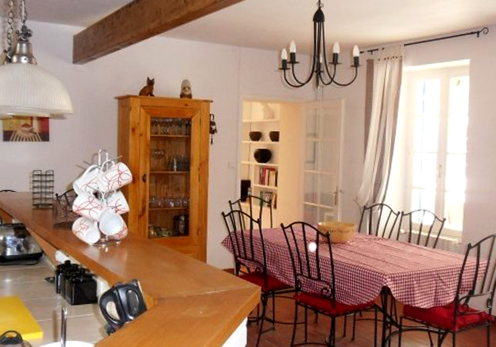 La Vigne Gallery Image / Kitchen and dining area of this converted stone built french farmhouse