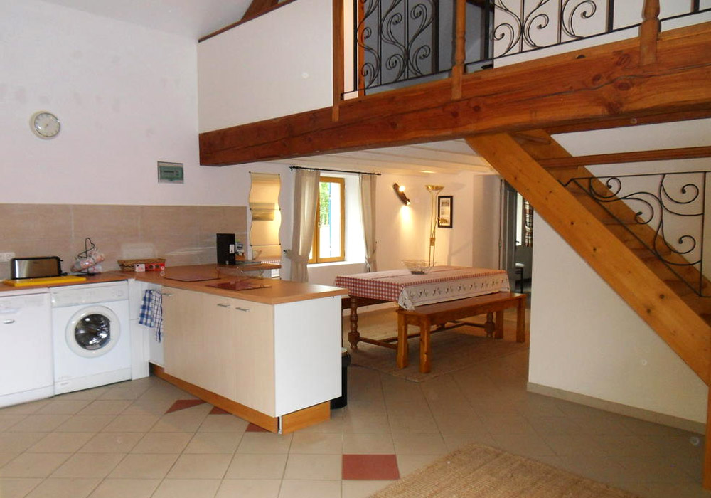Le Pineau Gallery Image / kitchen with mezzanine area above