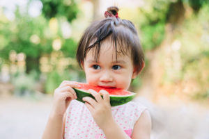 Eating watermelons in the summer sun
